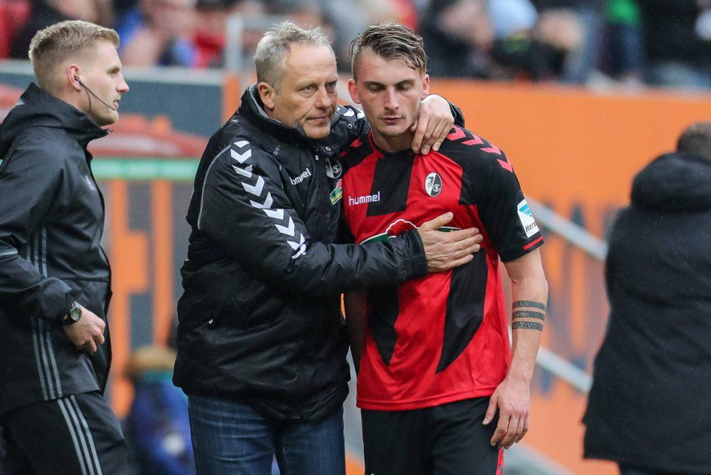 Christian Streich mit Maximilian Philipp, welcher zum BVB gewechselt ist
